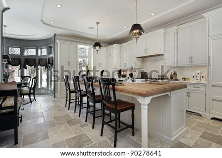 Kitchen in luxury home with wood counter island - stock photo