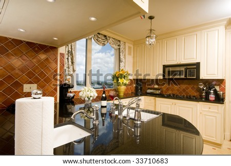 kitchen in luxury penthouse  suite with skyline views of new york city and the east river - stock photo