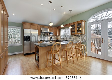Kitchen in modern home with door to deck - stock photo