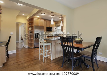 Kitchen in modern home with eating area - stock photo