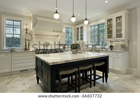 Kitchen in modern home with granite counter tops - stock photo