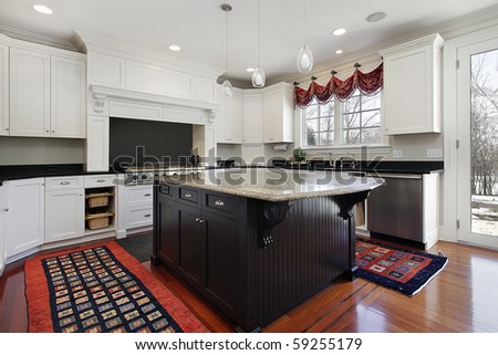 Kitchen in modern home with marble and wood island - stock photo