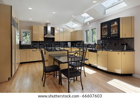 Kitchen in modern home with three skylights - stock photo