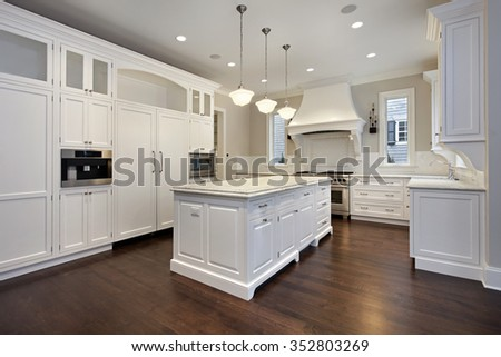 Kitchen in new construction home with center island - stock photo