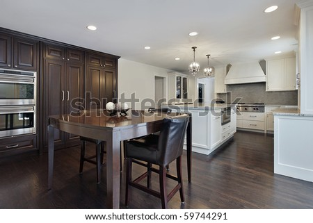 Kitchen in new construction home with dark wood cabinetry - stock photo