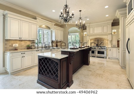 Kitchen in new construction home with double deck island - stock photo