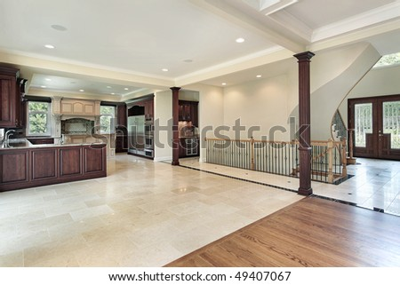 Kitchen in new construction home with foyer view - stock photo