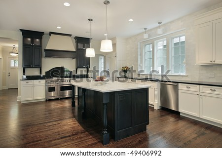 Kitchen in new construction home with large island - stock photo