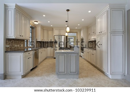 Kitchen in new construction home with stove on center island - stock photo