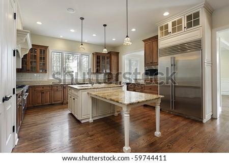 Kitchen in new construction home with wood cabinetry - stock photo