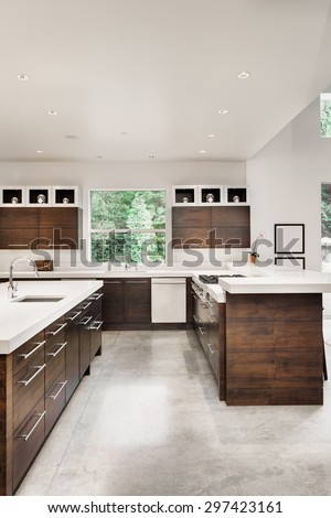 Kitchen in New Luxury Home with Island, Sink, Cabinets, and Table