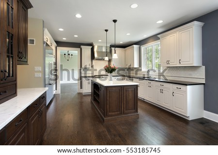 Kitchen in remodeled home with center island.
