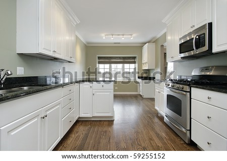 Kitchen in remodeled home with dark wood floors - stock photo