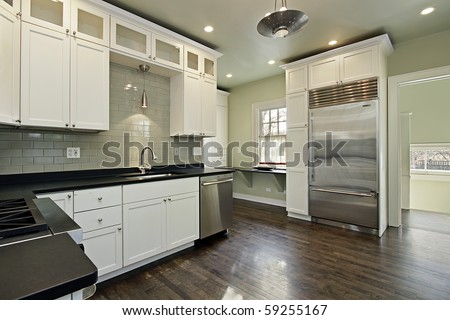 Kitchen in remodeled home with dark wood floors
