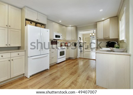 Kitchen in remodeled home with dining room view - stock photo