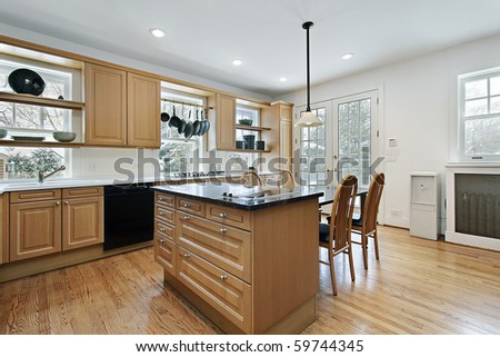 Kitchen in remodeled home with oak wood cabinetry