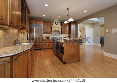 Kitchen in remodeled home with wood cabinetry - stock photo