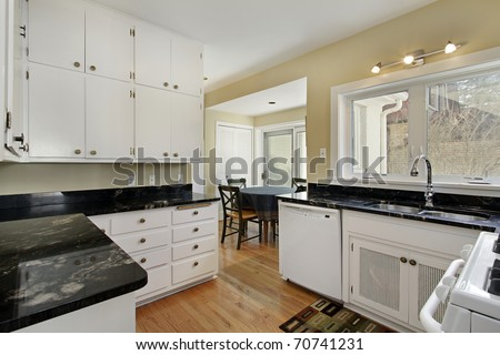 Kitchen in suburban home with adjacent breakfast room - stock photo