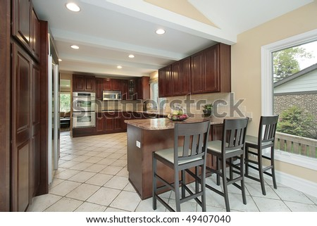 Kitchen in suburban home with breakfast bar
