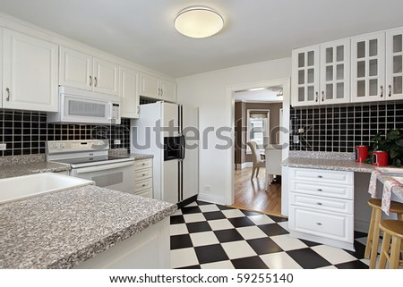 Kitchen in suburban home with checkerboard floor - stock photo