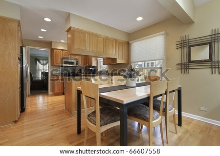 Kitchen in suburban home with eating area