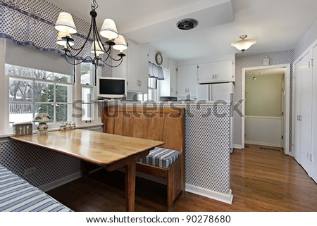 Kitchen in suburban home with eating area and bench