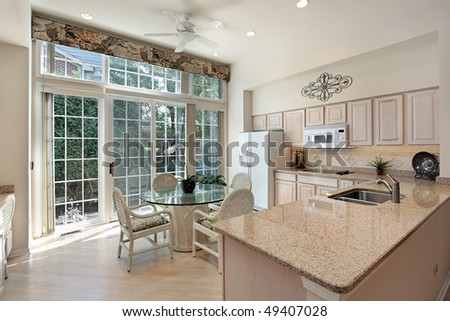 Kitchen in suburban home with sliding doors to patio - stock photo