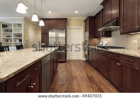 Kitchen in suburban town home with family room view - stock photo