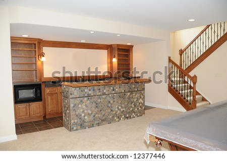 Kitchen In The Pool Room - A snack bar area in the game room of a luxury home. - stock photo