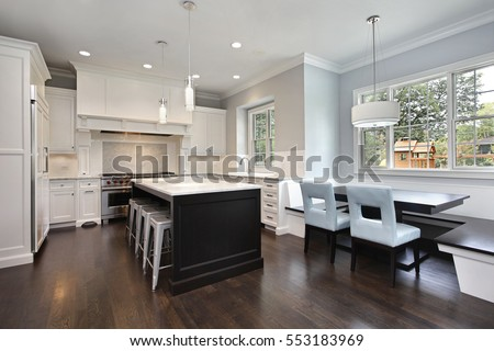Kitchen in upscale home with bench and table for eating