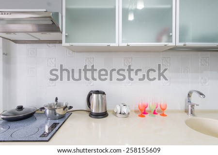 Kitchen interior closeup  in the frame contains a table, sink and gas stove - stock photo