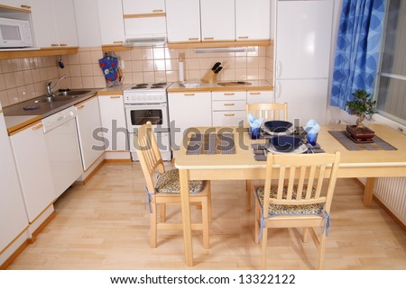 Kitchen interior detail with asian decorations and bonsai on the table - stock photo