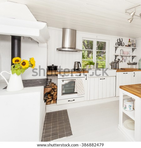 kitchen interior in a country-house with antique wood stove - stock photo