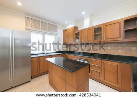 kitchen interior in new luxury home - stock photo