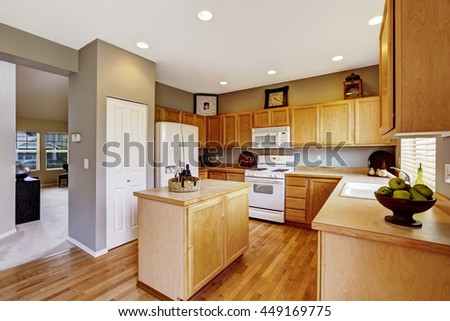 Kitchen interior with brown cabinets, hardwood floor and island