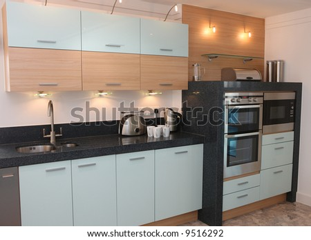Kitchen interior with integrated appliances - stock photo