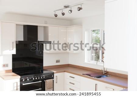Kitchen interior with wooden worktops shot - stock photo