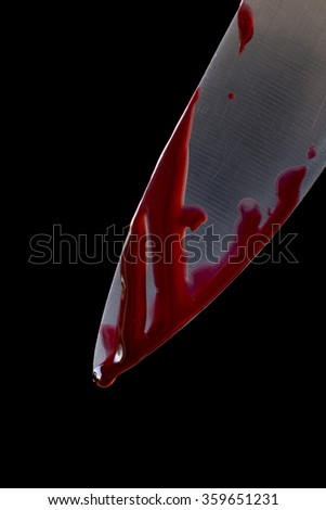 Kitchen knife dripping blood on black - stock photo