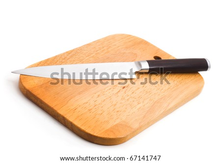 kitchen knife lying on a cutting board, white background - stock photo