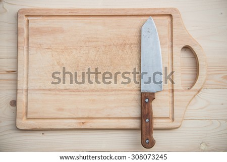 Kitchen Knife on a wooden - stock photo