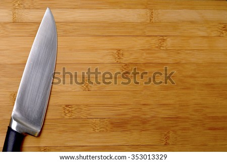kitchen knife with cutting board - stock photo