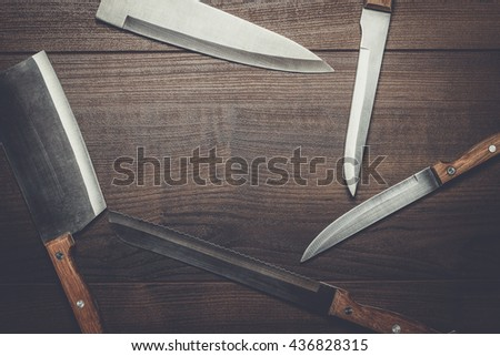 kitchen knifes on the brown wooden table background - stock photo