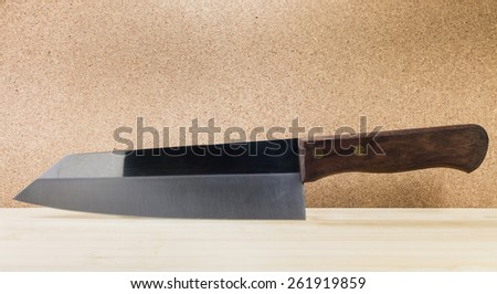 kitchen knifes on wooden table - stock photo