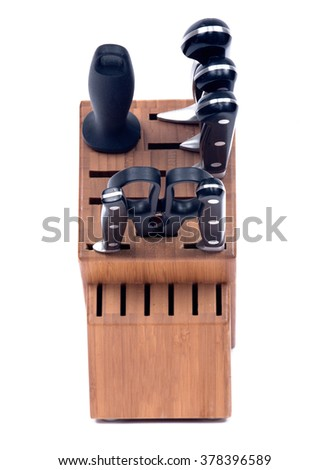 Kitchen knives set in wooden block - stock photo