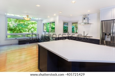 Kitchen more functional with a sink, cooktop, refrigerator and partially installed vent hood. Window seat bench bases installed - stock photo
