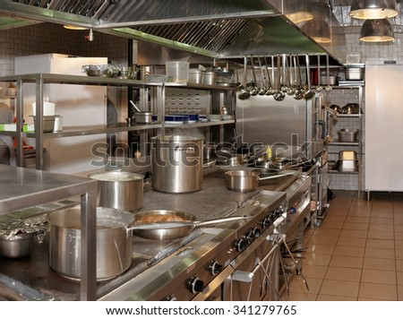 Kitchen of a restaurant shot in operation - stock photo