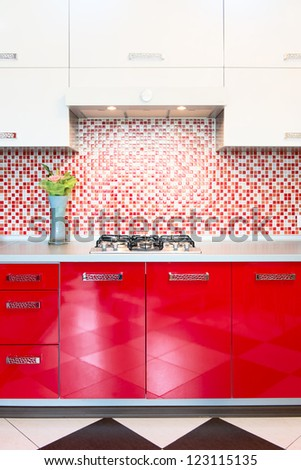 Kitchen red and white. Owen and flowers - stock photo