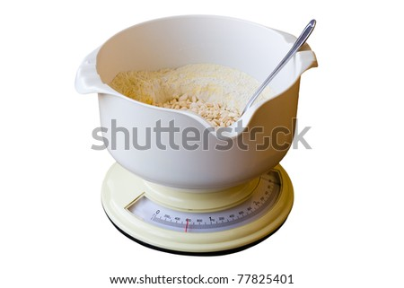 Kitchen scale with flour isolated on white background - stock photo