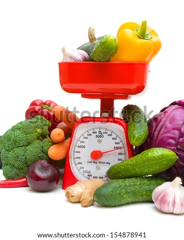 Kitchen scales and fresh ripe vegetables on white background. close-up - vertical photo. - stock photo