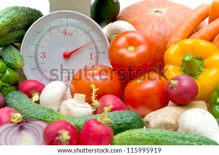kitchen scales and fresh vegetables close up - stock photo